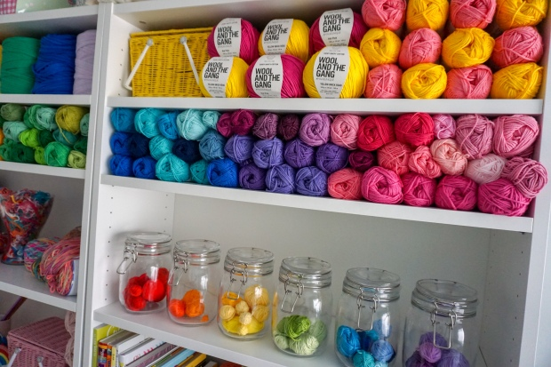 bookcases filled with colourful yarn