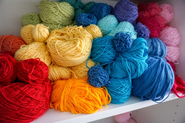 shelf full of colourful cotton yarn