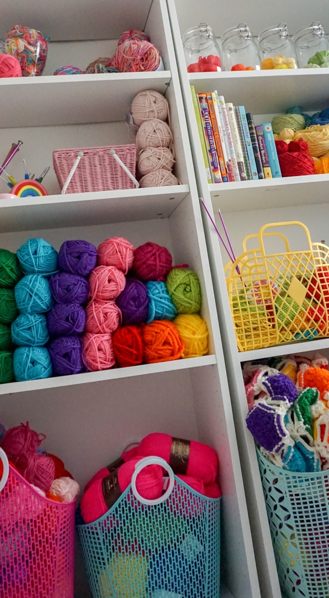 bookcase with colourful yarn storage and vintage jelly bags